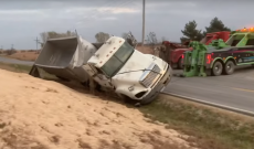 Greg Peterson avoids major collision but rolls grain truck into ditch