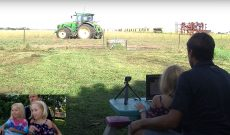 Farmer Derek teaches his kids to drive a tractor
